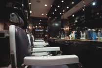 Barber chairs arranged in a row at barber shop — Stock Photo