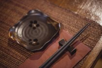 Close-up of chopsticks on dining table in restaurant — Stock Photo
