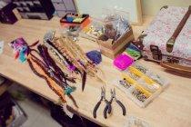 Artificial dreadlocks on desk in shop — Stock Photo