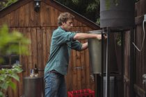 Man holding wort while making beer at home brewery — Stock Photo