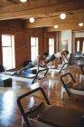 Women practicing pilates on reformers in fitness studio — Stock Photo