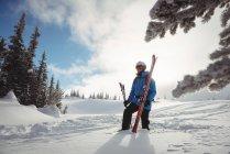 Skier walking with ski on snow covered mountain — Stock Photo