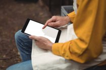 Mid section of man in apron using digital tablet at home brewery — Stock Photo