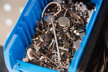 Close-up of used screws in a plastic box — Stock Photo