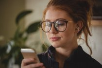 Beautiful woman using mobile phone — Stock Photo