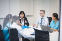 Team of doctors in a meeting at conference room — Stock Photo