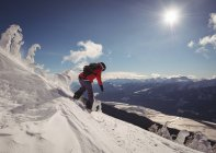 Skier skiing in snowy alps during winter — Stock Photo