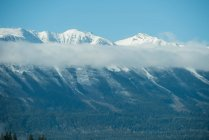 Tranquil view of snowy mountain range against blue sky — Stock Photo