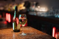 Close-up of white wine glass on bar counter at bar — Stock Photo
