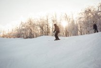 Two skiers skiing in snowy alps during winter — Stock Photo