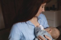 Close-up of mother breastfeeding baby in bedroom at home — Stock Photo