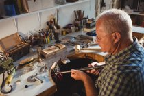 Goldsmith preparing work tool in workshop — Stock Photo