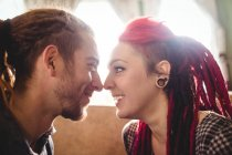Romantic hipster couple looking at each other in house — Stock Photo