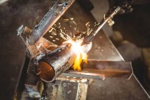 Sparks during metal welding in workshop — Stock Photo