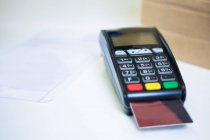 Payment terminal machine with credit card in shop — Stock Photo