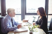 Businessman into discussion with colleague in office — Stock Photo