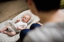 Selective focus of Mother looking at her baby at home — Stock Photo