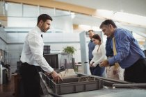 Passengers in airport security check at airport — Stock Photo