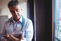 Doctor using digital tablet in hospital — Stock Photo