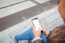 Cropped image of woman using smart phone — Stock Photo