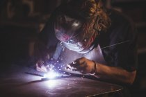 Close-up of blacksmith working at work shop — Stock Photo