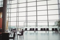Empty airport waiting room with big window in daytime — Stock Photo