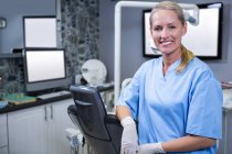 Dental assistant smiling at camera at dental clinic — Stock Photo