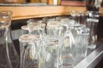 Close-up of various glasses at bar counter — Stock Photo