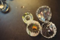 Close-up of glass slices on table at glassblowing factory — Stock Photo