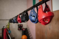 Close up of various headgears hanging in fitness studio — Stock Photo