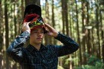 Athletic teenager wearing bicycle helmet in countryside — Stock Photo