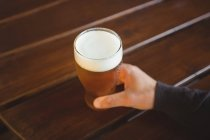 Man with glass of beer at bar — Stock Photo