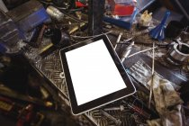Digital tablet and tools on workbench at workshop — Stock Photo