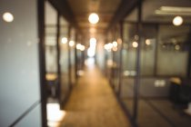 Blur view of modern office corridor and work space — Stock Photo