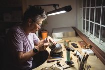 Close-up of craftswoman working in workshop — Stock Photo