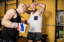Two Thai boxers practicing in gym — Stock Photo