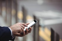 Close-up of businessman using mobile phone — Stock Photo