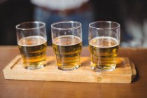 Close-up of beer glasses on the bar counter in bar — Stock Photo