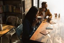 Romantic couple having coffee in cafe — Stock Photo