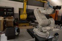 Современная роботизированная машина на складе — стоковое фото