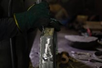 Close-up of worker using hydraulic machine in foundry workshop — Stock Photo