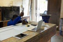 Male worker using vernier caliper in foundry workshop — Stock Photo