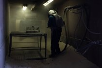 Male worker working in foundry workshop — Stock Photo