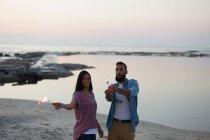 Romantic couple having fun on beach near sea side — Stock Photo
