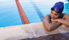 Front view of female swimmer waiting on the edge of the swimming pool — Stock Photo