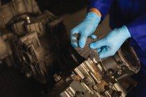 High angle view of bike mechanic repairing bike engine in garage — Stock Photo