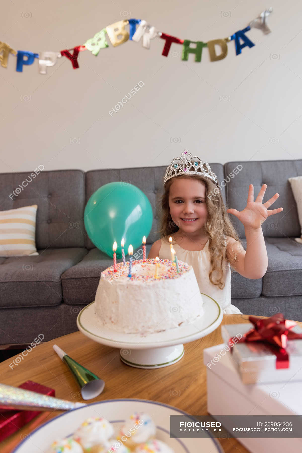 Stupendous Cute Girl Celebrating Her Birthday At Home Smiling Cake Stock Funny Birthday Cards Online Overcheapnameinfo