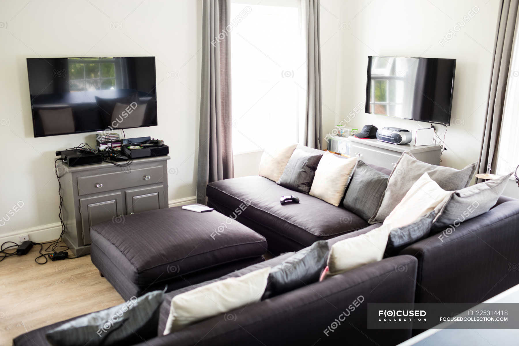 Empty Living Room With Sofa And Television At Home Stylish Residential Stock Photo 225314418