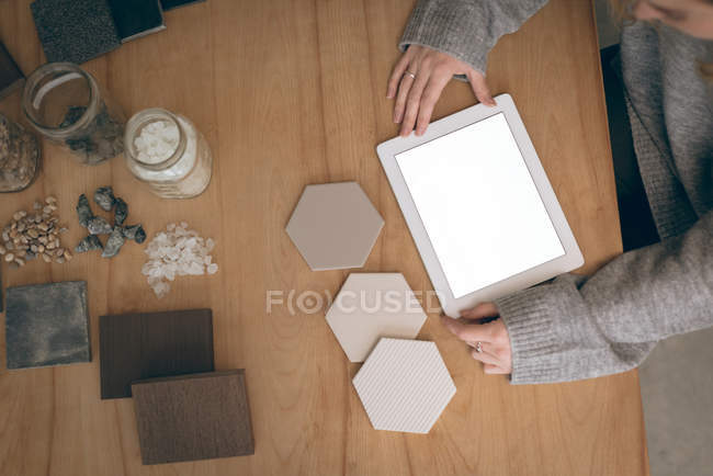Overhead of executive using digital tablet in office — Stock Photo