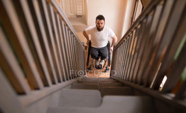 Portrait of disabled man in wheelchair looking at stairs — Stock Photo